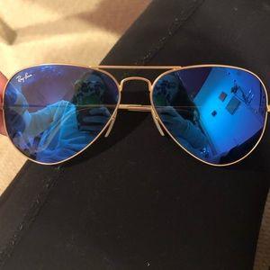 Blue reflective Ray Ban aviator sunglasses